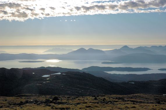 The car park at the top of the Bealach na Ba is 2,053 feet above sea level. From there can be seen dramatic views of Raasay and the Isle of Skye.